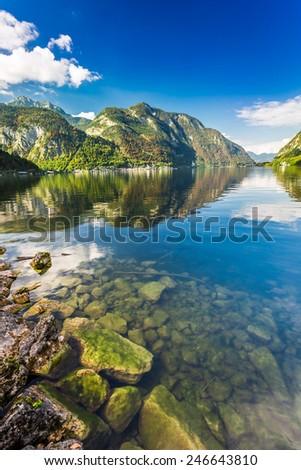 Crystal mountain lake at sunset - stock photo
