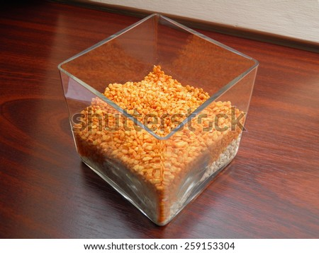 crystal orange prisms in a glass box as decoration - stock photo