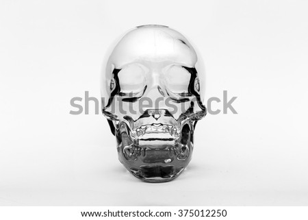 Crystal skull front on, ancient South American artifact on white background - stock photo
