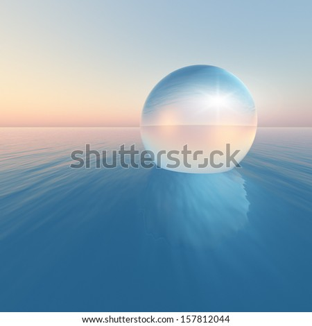 crystal sphere floating on the ocean under a clear sky. - stock photo