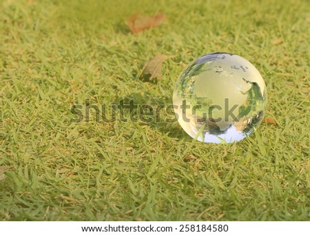 Crystal World Europe Zone with Thailand Ruins reflections on soft green grass background. - stock photo