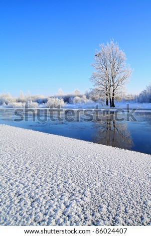 crystalline ice on coast river - stock photo