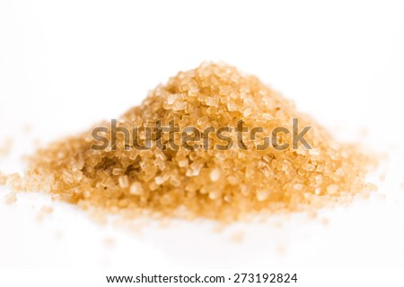 Crystals cane sugar heap close up isolated on white - stock photo