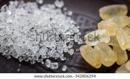 Crystals of white and brown sugar.