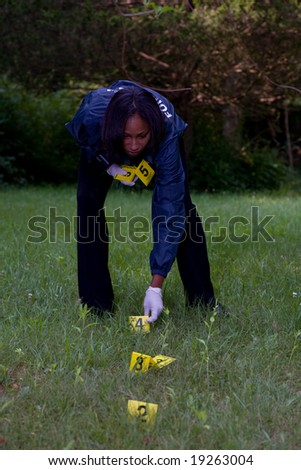 CSI places numbered markers near evidence. - stock photo