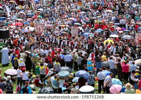 CSIKSOMLYO, ROMANIA - JUNE 7: Crowds of Hungarian pilgrims gather to celebrate the Pentecost and the catholic pilgrimage on June 7, 2014 in Sumuleu Ciuc (Csiksomlyo), Romania