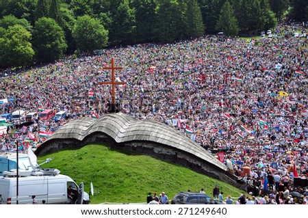 CSIKSOMLYO, ROMANIA - JUNE 7: Crowds of Hungarian pilgrims gather to celebrate the Pentecost and the catholic pilgrimage on June 7, 2014 in Sumuleu Ciuc (Csiksomlyo), Romania  - stock photo