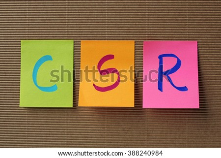 CSR (Corporate Social Responsibility) acronym on colorful sticky - stock photo