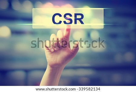 CSR - Corporate Social Responsibility concept with hand pressing a button on blurred abstract background  - stock photo