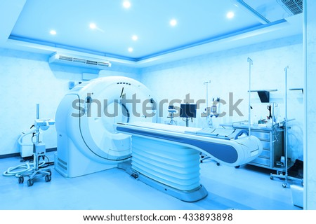 CT scanner room in hospital take with art lighting and blue filter - stock photo