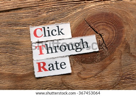 CTR - Click Through Rate written on paper on wood
