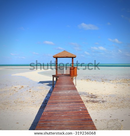 Cuba - Caribbean beach Cayo Guillermo. Sandy coast and seaside boardwalk. Jardines del Rey region. - stock photo