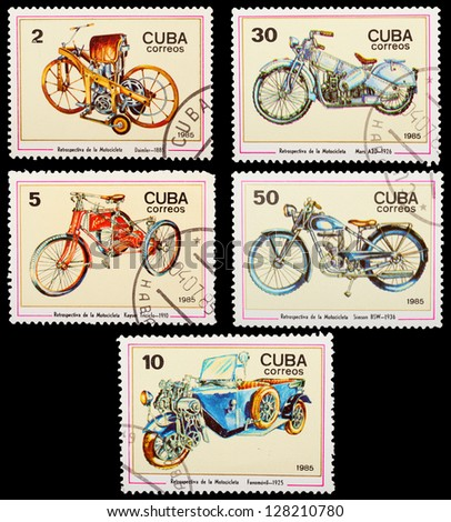 CUBA - CIRCA 1985: A set of postage stamps printed in CUBA shows historic cars, series, circa 1985 - stock photo