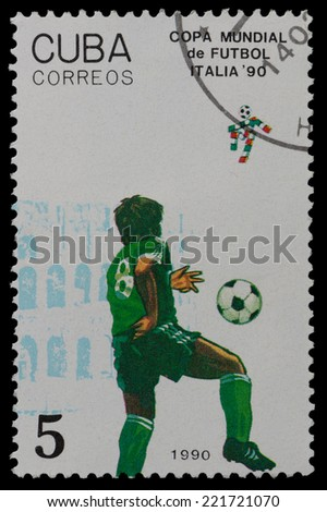 CUBA - CIRCA 1990: a stamp printed by CUBA shows football players. World football cup in Italy,  circa 1990 - stock photo