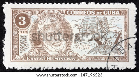 "CUBA - CIRCA 1963: A stamp printed by CUBA shows image portrait of Nobel Prize-winner for Literature famous American writer Ernest Hemingway (1899-1961), ""The Old Man and The Sea"", circa 1963"