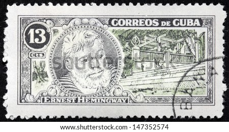 CUBA - CIRCA 1963: A stamp printed by CUBA shows image portrait of Nobel Prize-winner for Literature famous American writer Ernest Hemingway (1899-1961), circa 1963. - stock photo
