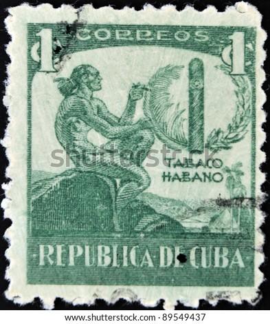 CUBA - CIRCA 1946: A stamp printed in Cuba dedicated to Havana snuff, circa 1946 - stock photo