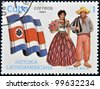 CUBA - CIRCA 1990: A stamp printed in Cuba dedicated to Latin American history, shows typical costume and flag of Costa Rica, circa 1990 - stock photo