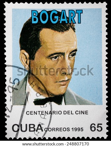 "CUBA - CIRCA 1995: A stamp printed in Cuba from the ""Centenary of Motion Pictures. Designs showing film stars"" issue shows Humphrey Bogart, circa 1995. - stock photo"