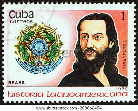 """CUBA - CIRCA 1988: A stamp printed in Cuba from the """"Latin American History (3rd series)"""" issue shows Coat of Arms and A. de Silva Xavier """" Tiradentes """" (Brazil), circa 1988.  - stock photo"""