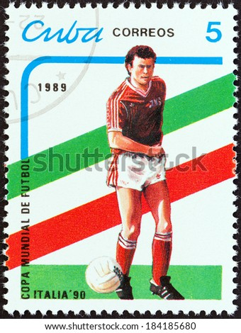 "CUBA - CIRCA 1989: A stamp printed in Cuba from the ""World Cup Football Championship, Italy 1990 "" issue shows footballer, circa 1989. - stock photo"