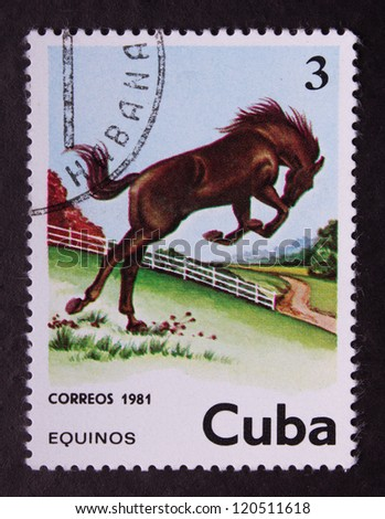 CUBA - CIRCA 1981: A stamp printed in Cuba shows brown horse jumping on a place and village scene on its background, circa 1981.