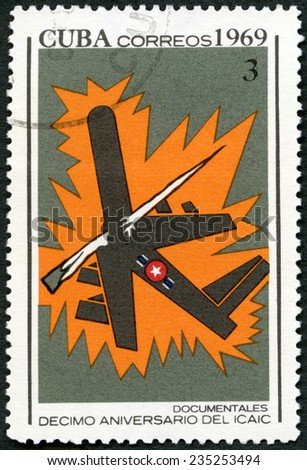 CUBA - CIRCA 1969: A stamp printed in Cuba shows Documentaries, devoted National Film Industry, 10th anniversary, circa 1969  - stock photo