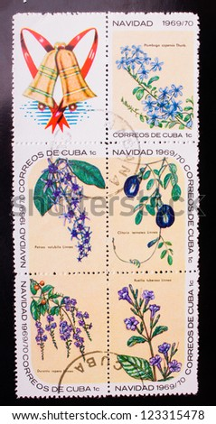 CUBA - CIRCA 1969: A stamp printed in Cuba shows five kinds of blue flowers , circa 1969. - stock photo