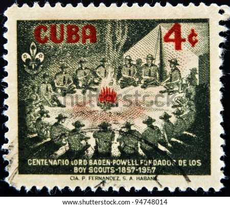 CUBA - CIRCA 1957: A stamp printed in Cuba shows image of scouts around a campfire, celebrating the centenary of scouting, circa 1957