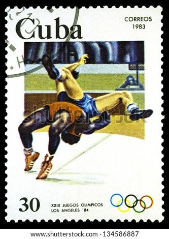 "CUBA - CIRCA 1983: A stamp printed in CUBA shows Wrestling, with inscription and name of series ""Olympic Games, Los Angeles 1984"", circa 1983"