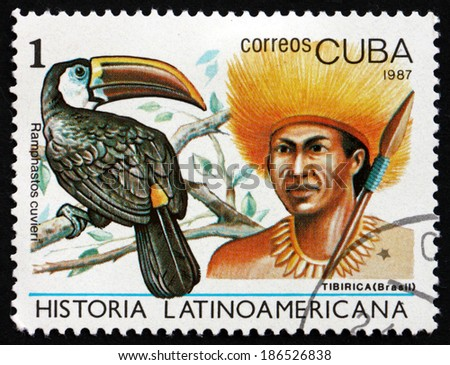 CUBA - CIRCA 1987: a stamp printed in the Cuba shows Cuvier'??s Toucan, Ramphastos Cuvieri, Tibirica Indian of Brazil, circa 1987 - stock photo