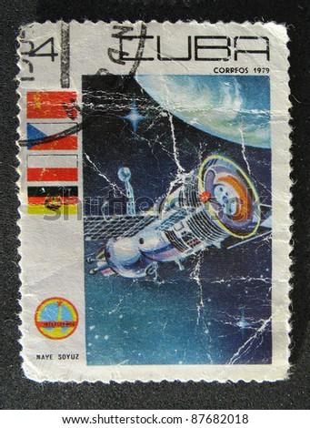 CUBA - CIRCA 1979: A vintage postal stamp printed in Cuba, depicting a space satellite named Nave Soyuz in orbit circa 1979 - stock photo