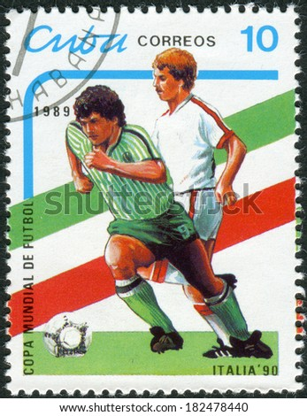 CUBA - CIRCA 1989: Postage stamp printed in Cuba, devoted to World Cup Football Italy 90, shows football players, circa 1989 - stock photo