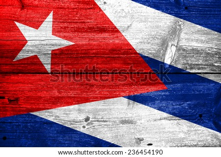 Cuba Flag painted on old wood plank texture - stock photo