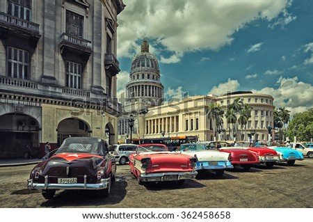 CUBA, HAVANA-JULY 10, 2015: Old American cars in the parking in front of the Capitol. These vintage cars are an iconic sight of the Cuba - stock photo