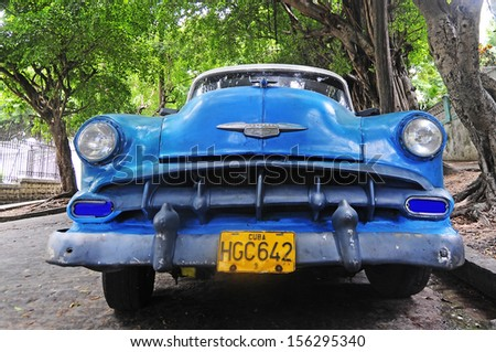 CUBA, HAVANA - JUNE 26, 2013: Classic old American car on the streets of Havana. Classic cars are still in use in Cuba and old timers have become an iconic view and a worldwide known attraction - stock photo