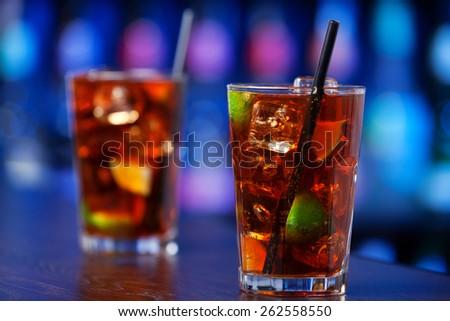 Cuba libre cocktails on a bar counter - stock photo