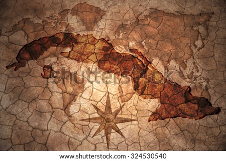 cuba map on vintage crack paper background - stock photo