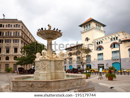 Cuba. Old Havana. Sierra Maestra Havana and fountain of lions on San Francisco Square  - stock photo