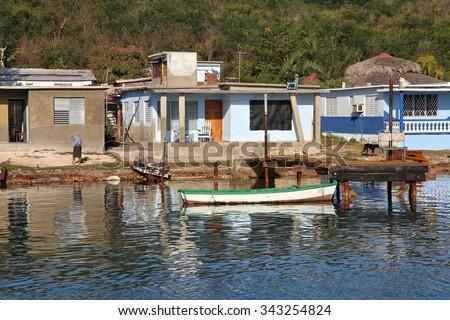 Cuba - seaside fishing village near Cienfuegos. Morning water reflection. - stock photo