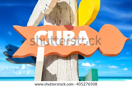 Cuba signpost with beach background - stock photo
