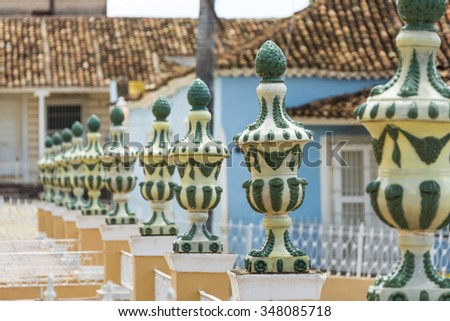 Cuba tourism: Trinidad main plaza architectural detail. Line of decorations surrounding the plaza. Trinidad is a Unesco World Heritage site and a major landmark in the province of Sancti Spirtus - stock photo