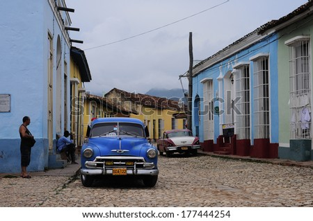 CUBA, TRINIDAD - JULY 6, 2013: Classic old American car on the streets of Trinidad.  Classic cars are still in use in Cuba and old timers have become an iconic view and a worldwide known attraction - stock photo
