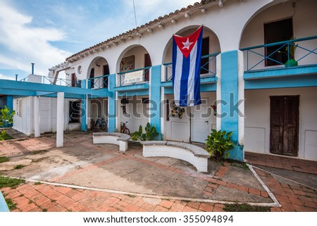 Cuban bandera or flag displayed on colonial building - stock photo