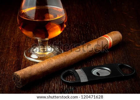 cuban cigar with a glass o rum - stock photo