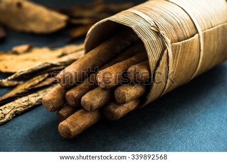 Cuban cigars in traditional artisan palm leafs box - stock photo