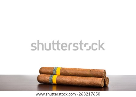Cuban cigars isolated on wooden bar and white background - stock photo