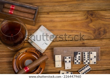 Cuban cigars rum and domino on table - stock photo