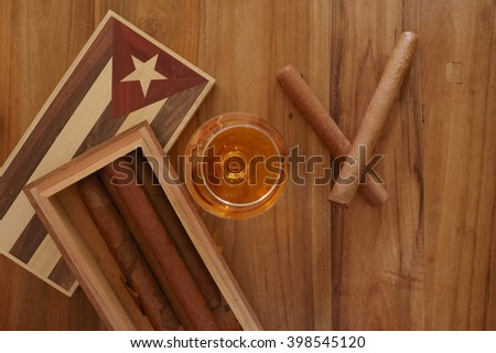 Cuban cigars with vintage cigar box and rum - stock photo