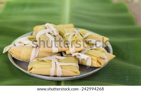 Cuban cuisine: traditional homemade tamal a popular Latin American dish which takes lot of hard work to prepare - stock photo